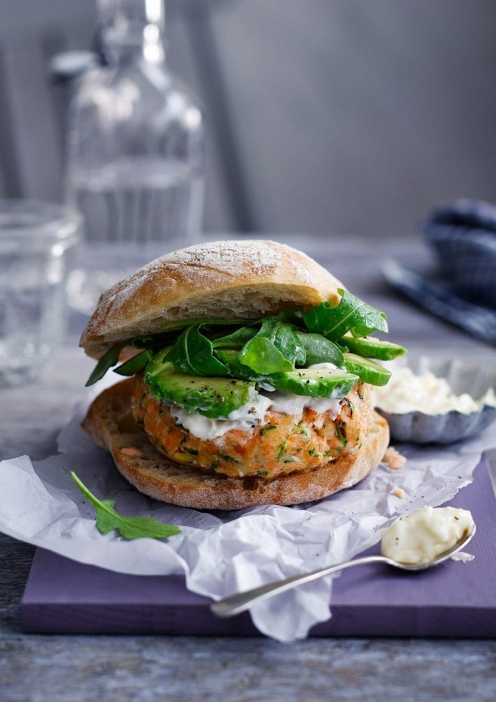 Salmon Avocado Burgers served with rocket and mayonnaise