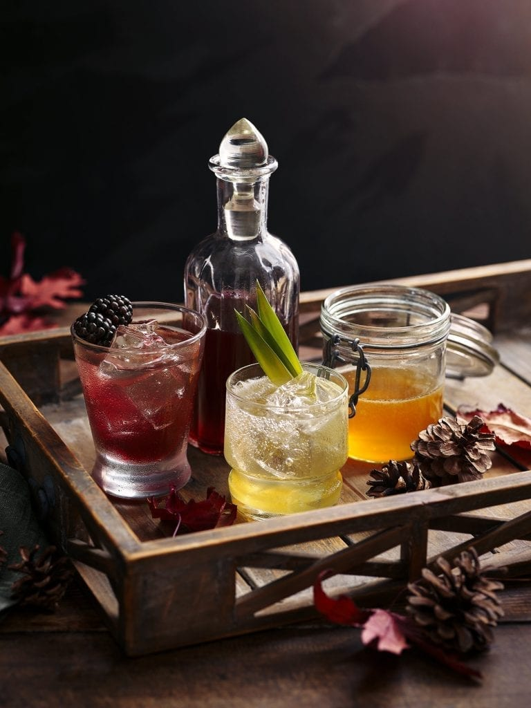 winter warmer drinks with autumn fruits and leaves photographed for co op magazine