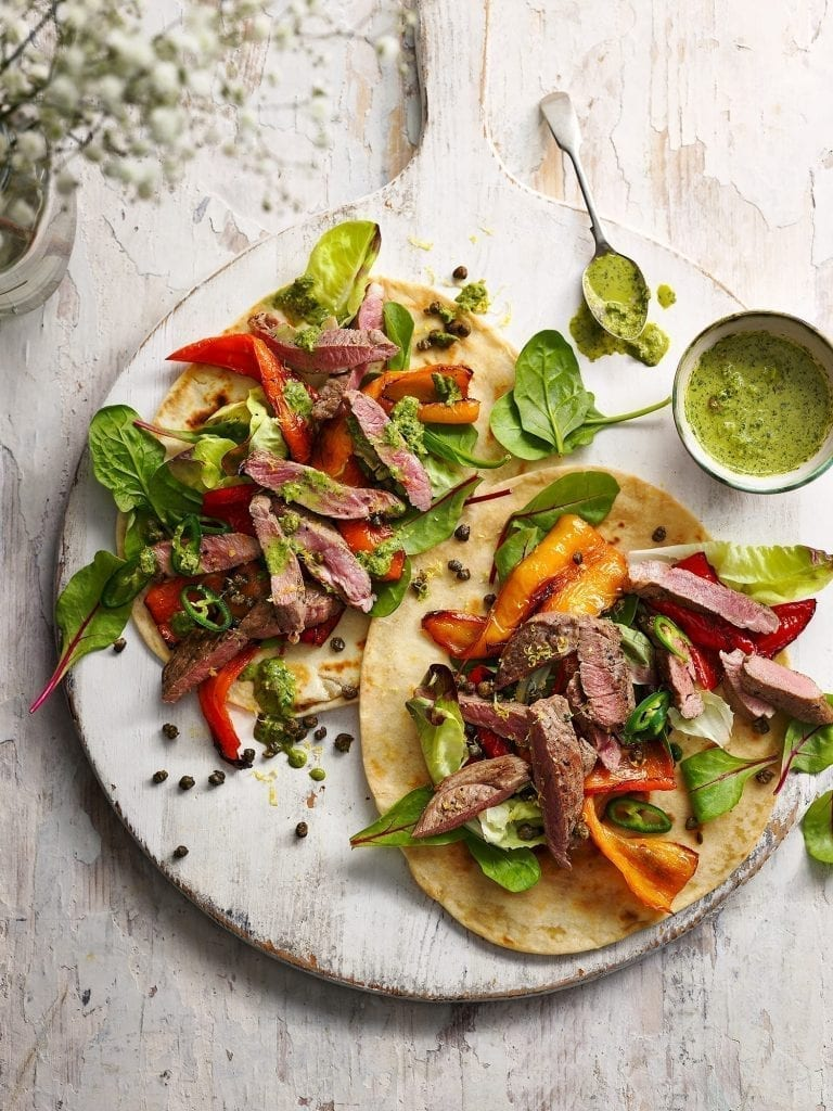 delicious magazine may 2020 midweek lamb steak flat bread with green chilli caper dressing