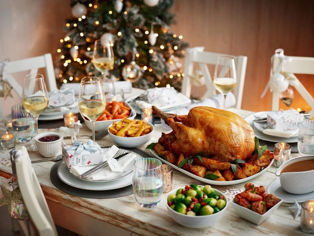 Table set for Christmas dinner with turkey and vegetables