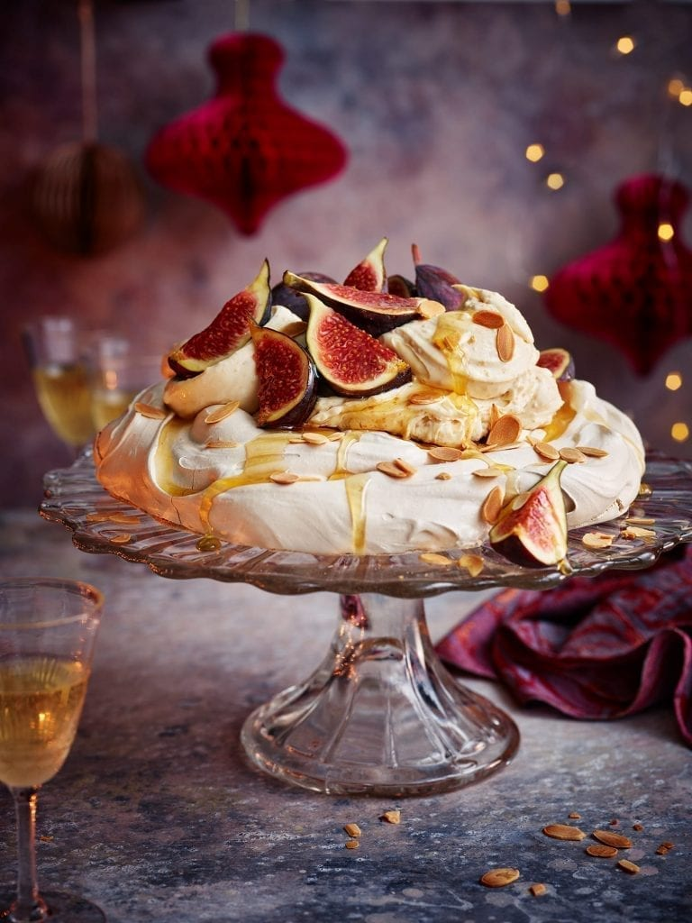 Cinnamon pavlova with praline cream and figs for christmas