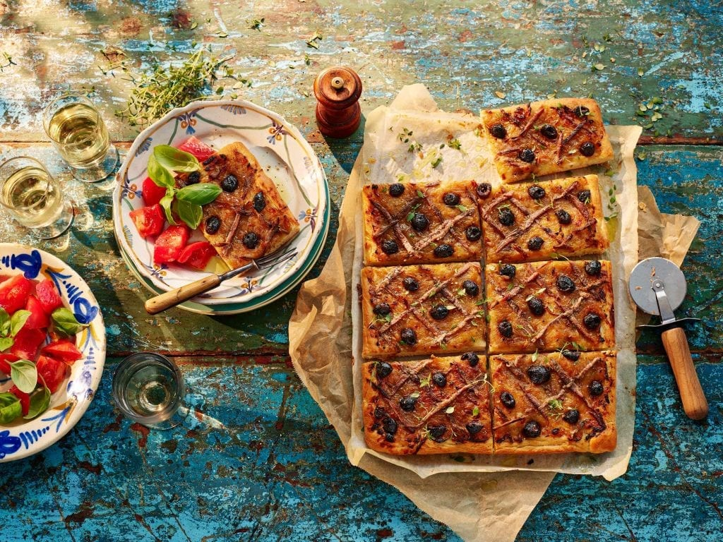 Pissaladiere on board with salad