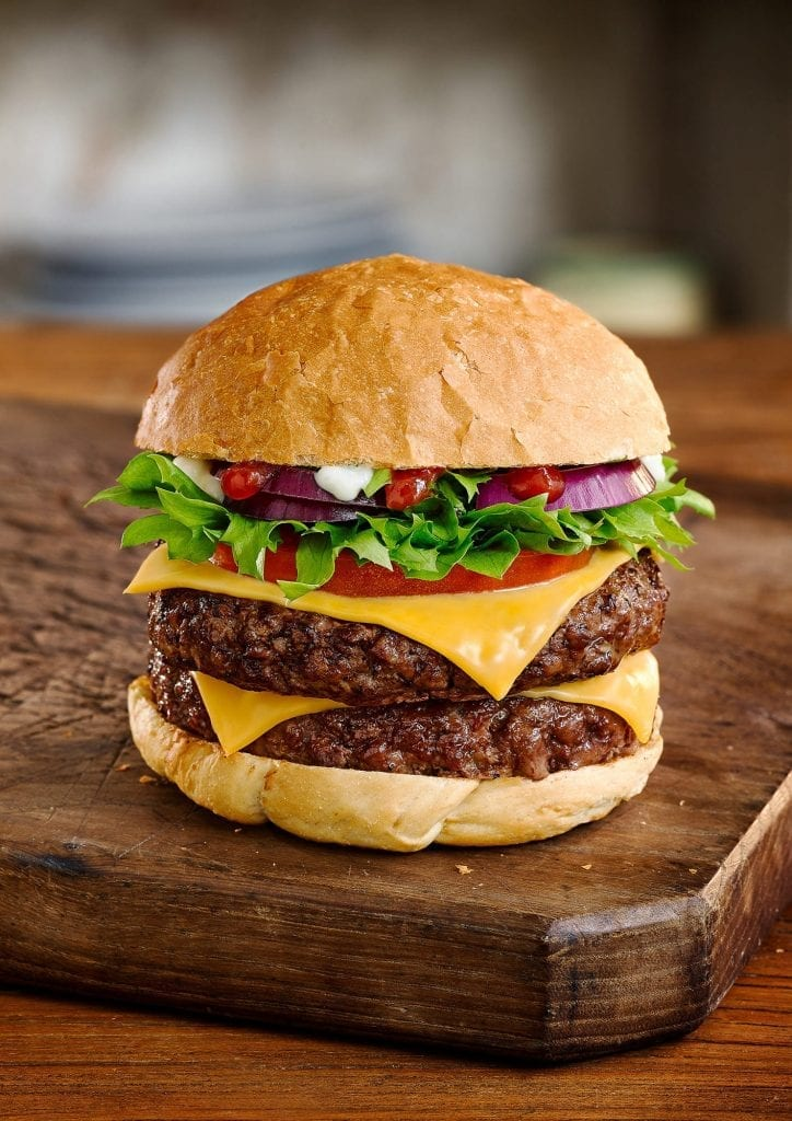 cheeseburger with lettuce onion and tomato