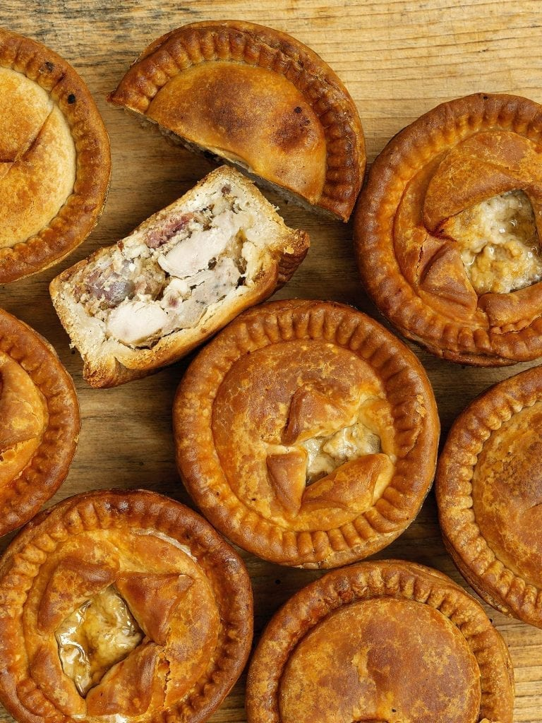 Pork pies with one sliced in half