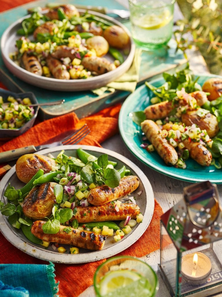 slimming world magazine august 2021 bbq sausages with pineapple salsa roast potatoes and watercress salad