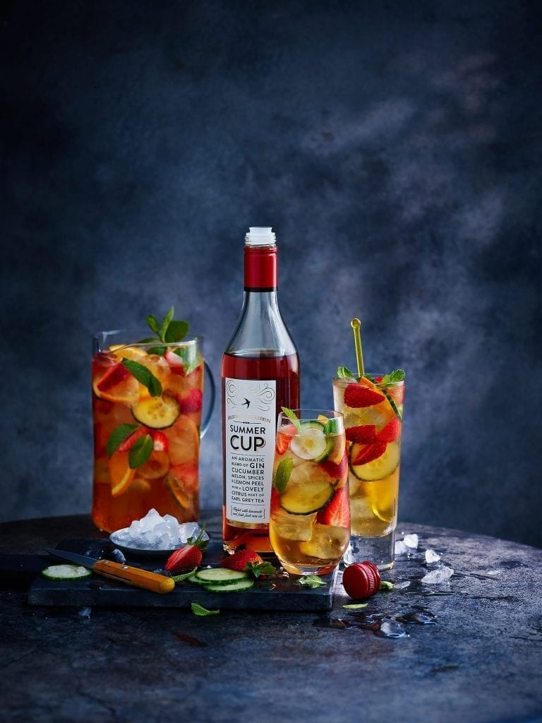 Pimms bottle with fruit filled glasses for marks and spencers