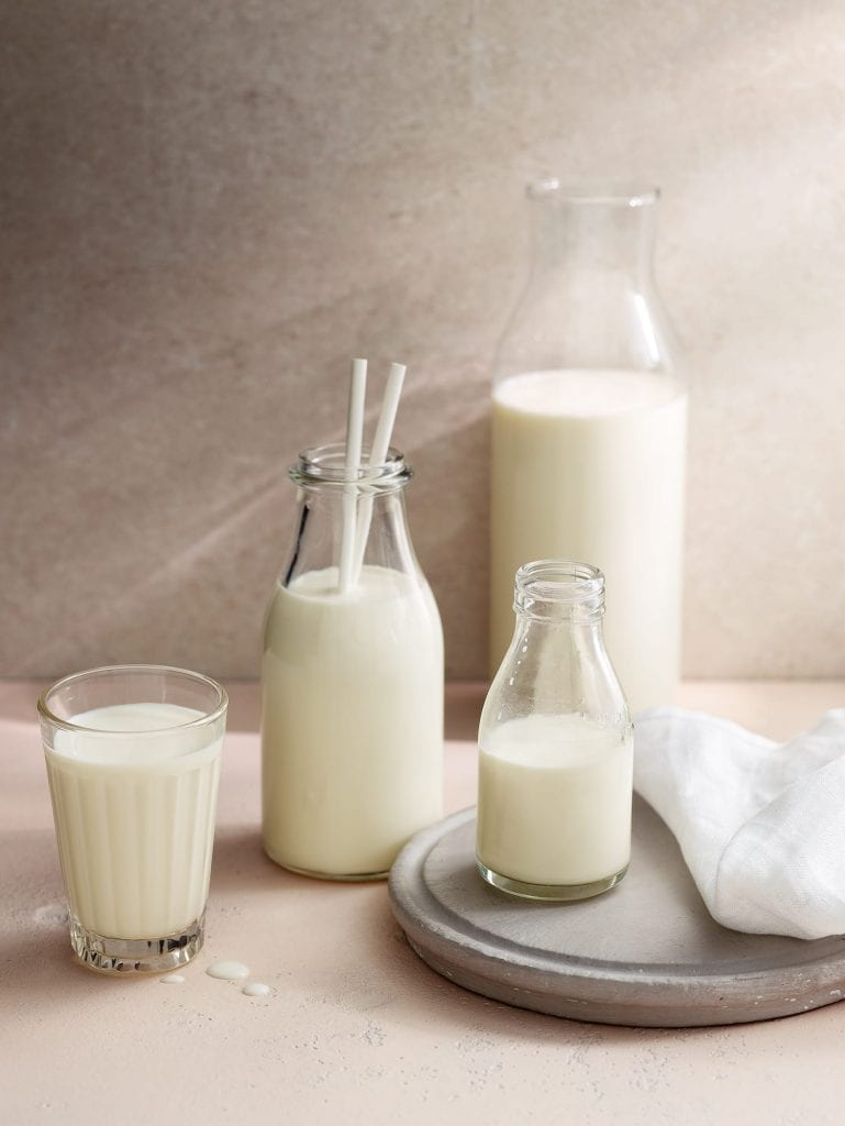 milk glasses bottles in various sizes