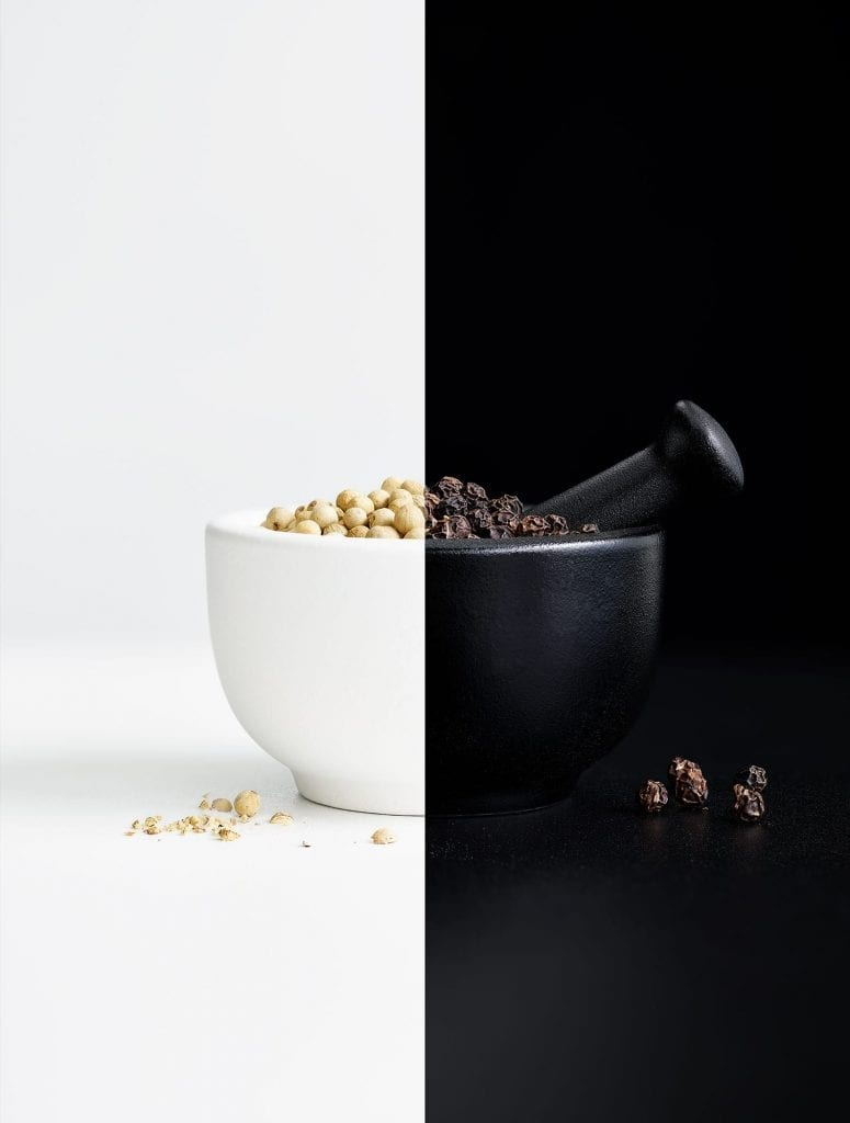 Black and white pepper with a pestle and mortar