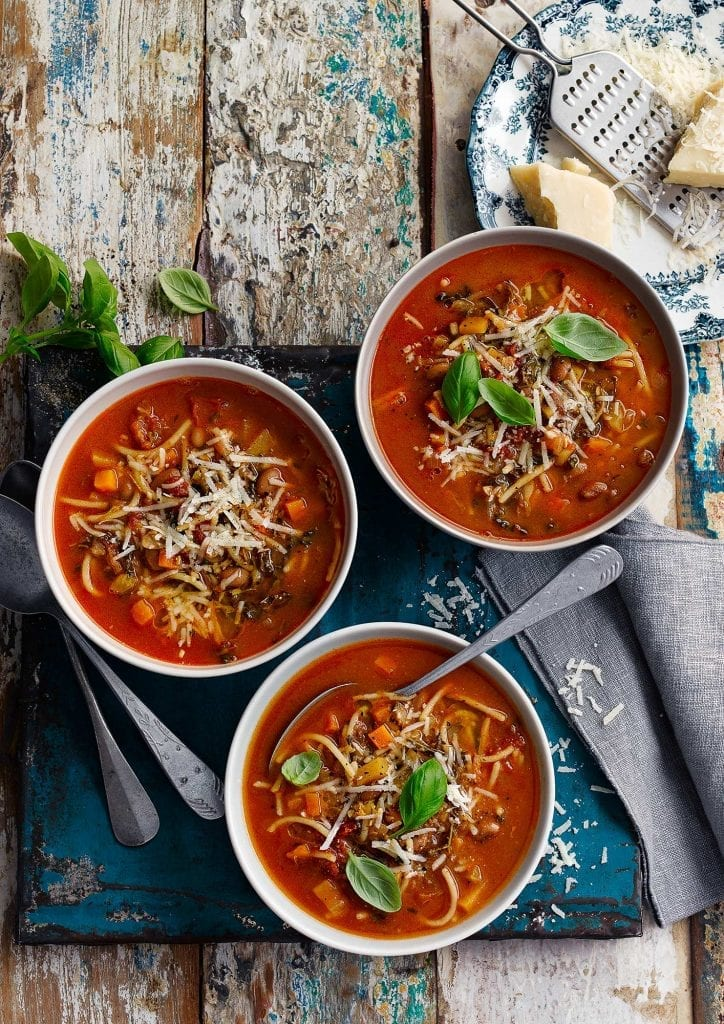 Minestrone soup with grated cheddar cheese